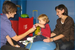 Speech Therapist and Parent Playing with Child