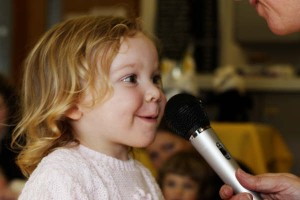 Child Singing into Microphone