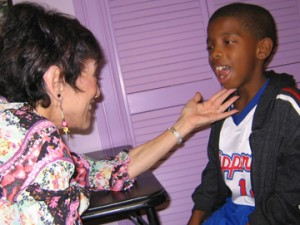 Speech Therapist Working with Child with Tongue Thrust