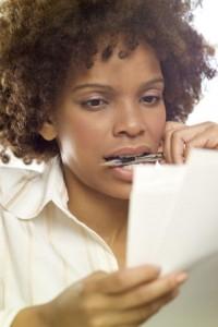 Woman Studying Paperwork