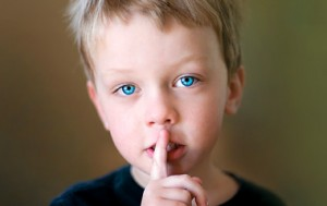 Child with Finger Over Lips