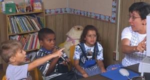 Speech Therapist Working With Children in School