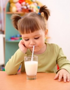 Child Drinking With Straw