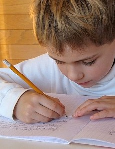 Child Writing with Pencil