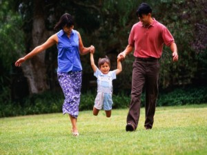 Parents Taking Child for Walk