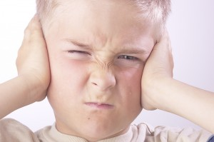 Autistic Child Covering Ears