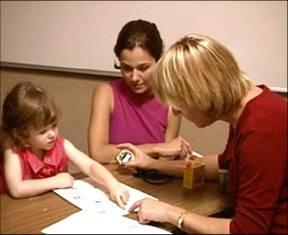 Child Working with Speech Therapist