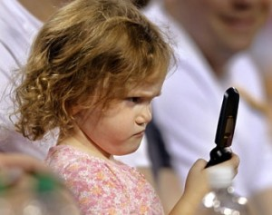 Frustrated Child Looking at the Phone