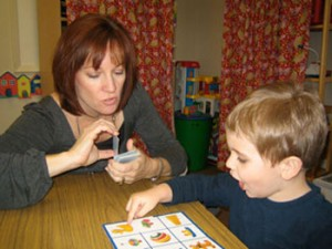 Speech Therapist Working with Child on Vocabulary