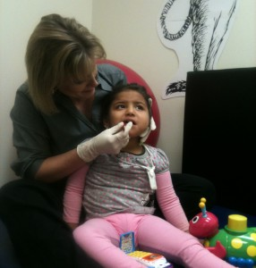 Speech Therapist Working with Child with Feeding or Swallowing Disorder
