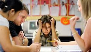Speech Therapist Working with Child in School