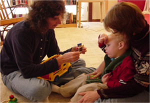 Speech Therapist Working with Child with Tracheostomy