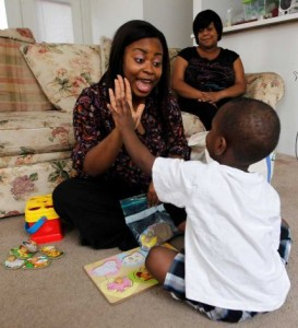 Speech Therapist Giving Child High Five
