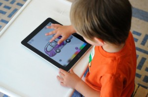 Child Using an iPad App