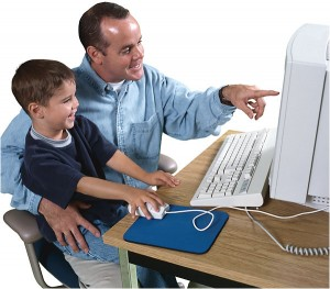 Child and Dad Using Commputer