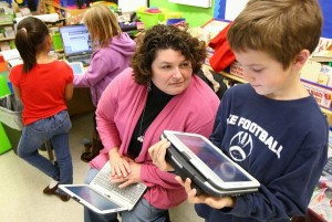 Child Working with Apps in Classroom