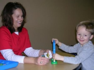 Speech Therapist Working with Child on Articulation