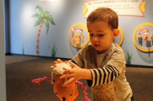 Boy Playing with Mr. Potato Head