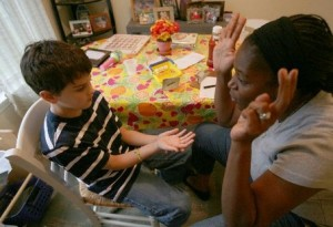 Speech Therapist Working with Autistic Child