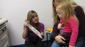 Speech Therapist Working with Child with Down Syndrome