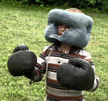 Child Wearing Boxing Equipment