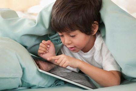Child Using App Under Blanket
