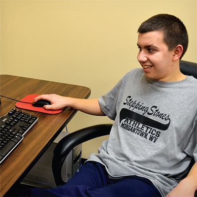 Teen with Fragile X Using a Computer