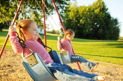 Child on Swingset