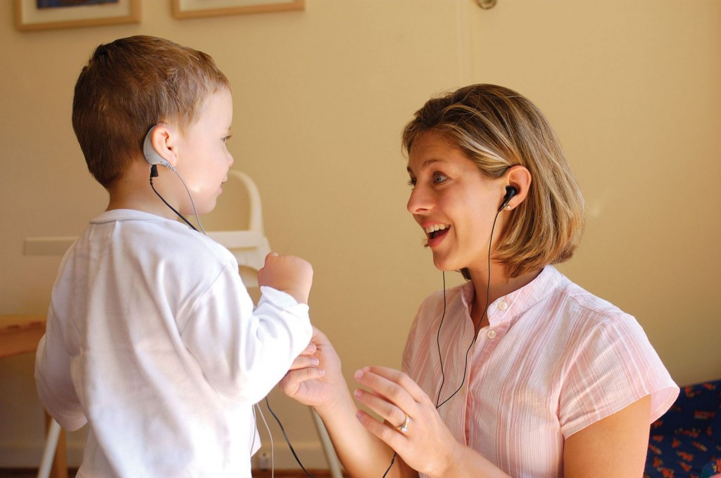 Audiologist and Child with Cochlear Implants