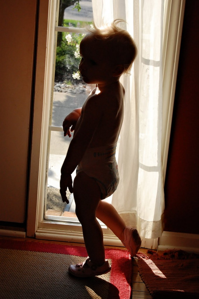 Child Silhouette Against Window