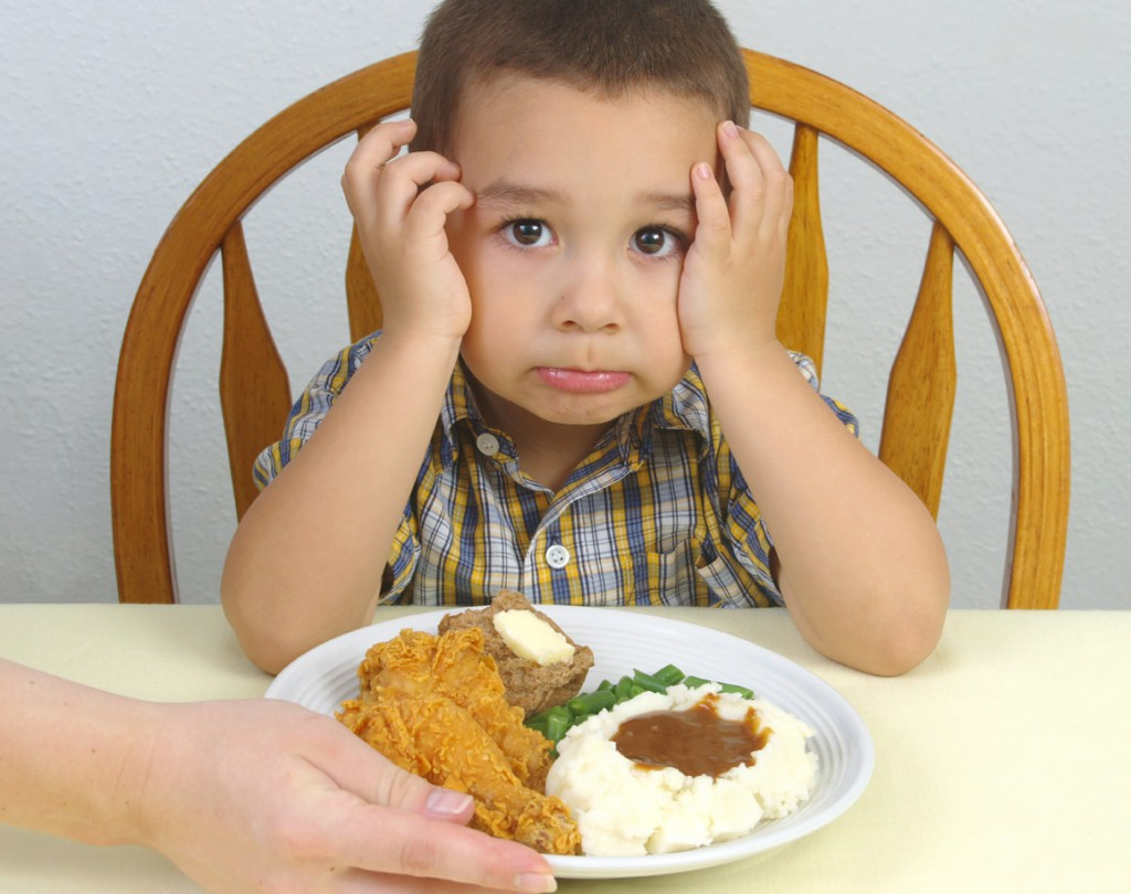 Boy Refusing to Eat Dinner