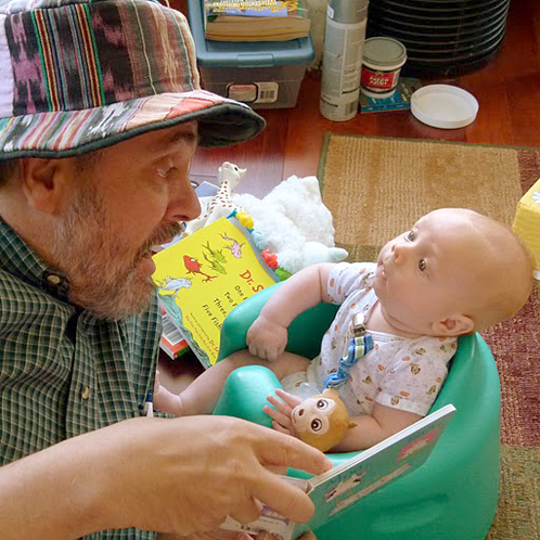 Baby and Dad Reading