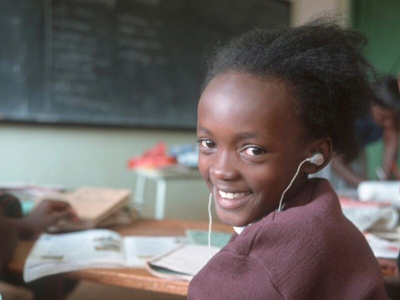 Child with Headphones in a Classroom