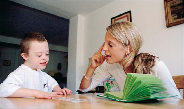 Boy with Down Sydrome in Speech Therapy