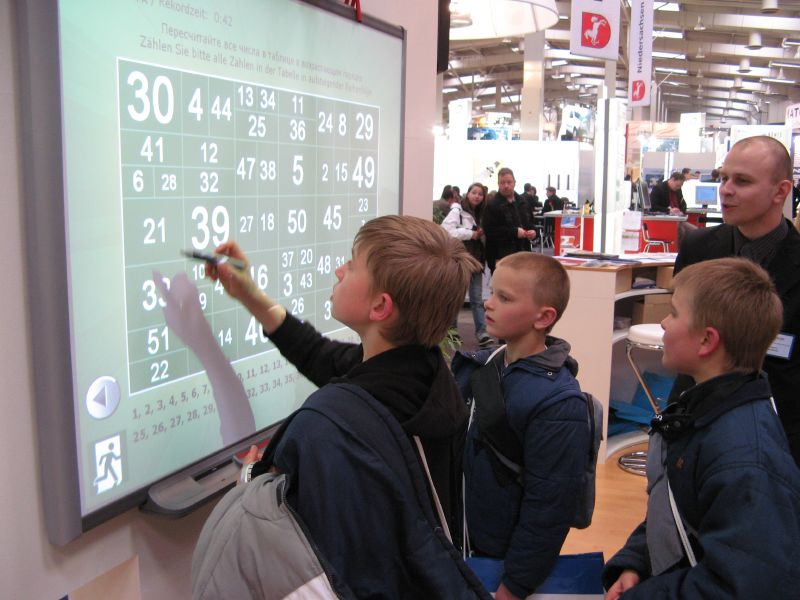 students with interactive whiteboard