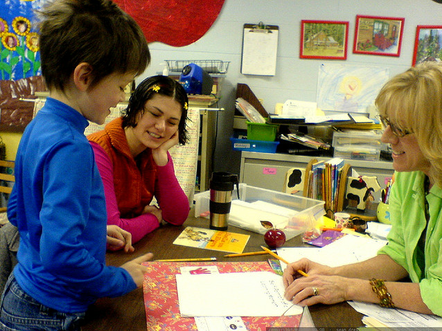 parent and teacher in conference with student