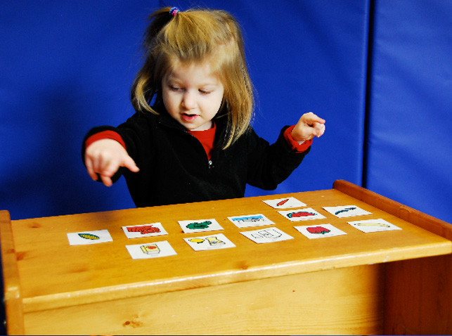 girl using symbol cards in therapy