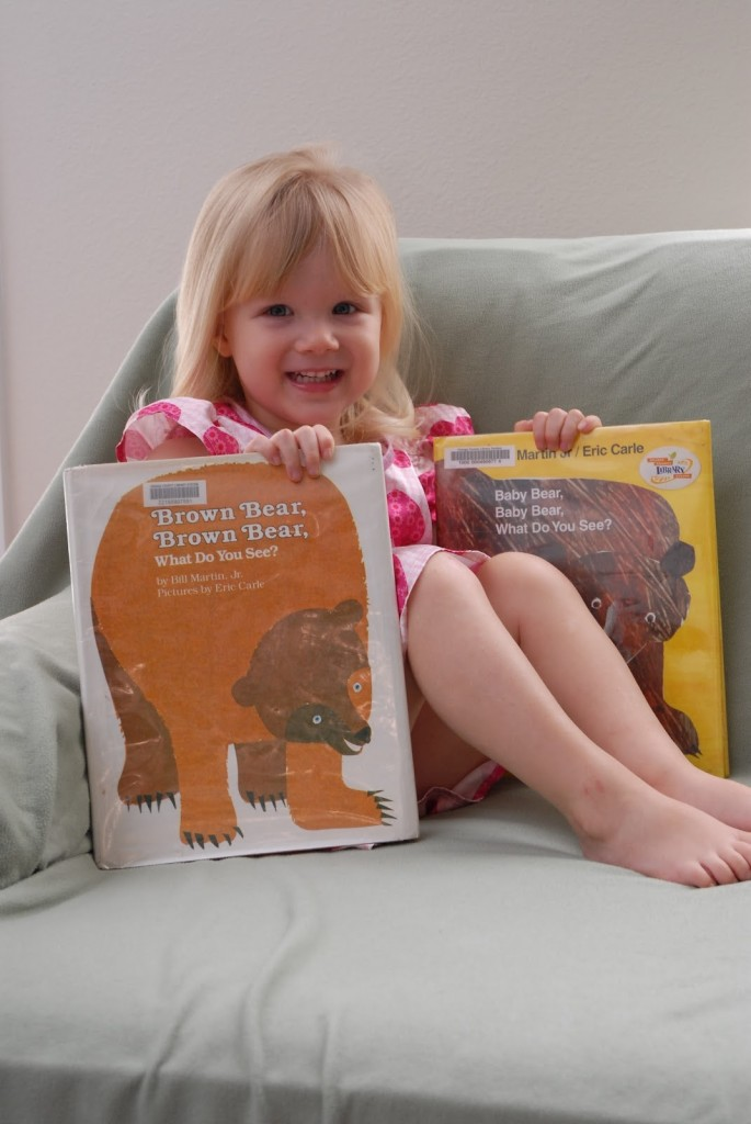 child reading Brown Bear